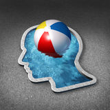 Leisure Thinking. Concept and mental relaxation symbol as a swimming pool shaped as a human face with a beach ball representing the brain as a metaphor for Royalty Free Stock Photo