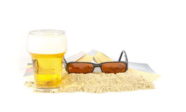 Leisure time on the beach with a book and a beer Royalty Free Stock Images