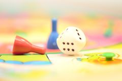 Leisure time board game. With dice and chips Stock Photography