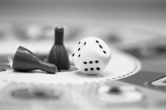 Dice and chips in b. Leisure time board game with dice and chips in black and white royalty free stock images