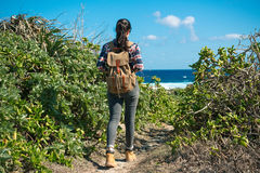 Leisure traveler woman hiking on national park. Freedom leisure traveler woman hiking on national park and looking at blue sea landscape enjoying wind with sunny Royalty Free Stock Image