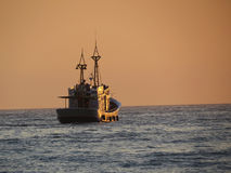 Leisure Trawler Boat at Sunset Royalty Free Stock Photo