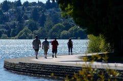 Leisure walk beside lake royalty free stock photos