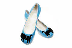 Leisure women's shoes. A pair of blue women's shoes on white background Royalty Free Stock Photo