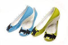 Leisure women's shoes. Two pairs of blue and green leisure shoes on white Stock Photo