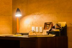 Leisure working desk under a glowing lamp.  Stock Images