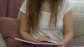 Leisure youth carefree pastime casual girl home. Leisure youth carefree pastime. casual teenage girl sitting at home with notebook stock video