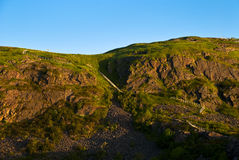 Leisurely Climb. Signal Hill Newfoundland showing potion of Cliff Side Trail during Sunrise Stock Image