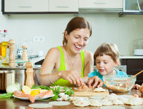 Leisurely makes dumplings with red fish in a home kitchen Royalty Free Stock Photo