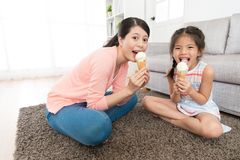Leisurely mother with little girl eating ice cream royalty free stock photo