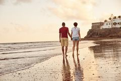 Leisurely stroll through the breaking waves Stock Images