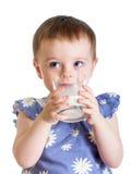 Leite bebendo da criança do vidro isolado Imagens de Stock Royalty Free