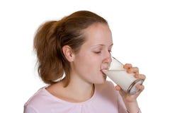 Leite bebendo da menina Fotos de Stock Royalty Free