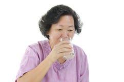 Leite bebendo da mulher superior com vidro Imagem de Stock Royalty Free