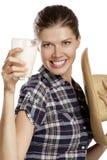 Leite bebendo de mulher nova Imagens de Stock