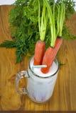 Leite e cenouras Foto de Stock