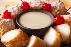 Leite fritado com leite condensado e cerejas macro horizontal fotografia de stock royalty free
