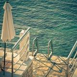 Leiter zum Meer Stockbild
