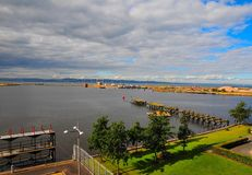Leith docks. From Leith Docks out across the river Forth estuary with the coastline of Fifeshire on the far side Royalty Free Stock Photo