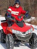 Leitungsfahrradmitfahrer auf Schnee Stockfotos