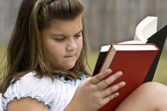 Leitura da criança Foto de Stock