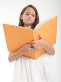 Leitura da rapariga Foto de Stock