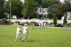 Lek av gräsmattabunkar - klubba för Oakville gräsmattabowling Royaltyfri Fotografi