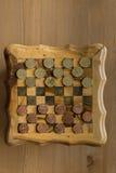 Lek av kontrollörer - USA-cent VS eurocents Royaltyfria Bilder