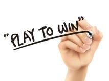 Lek som segrar ord som är skriftliga vid handen 3d Royaltyfri Fotografi