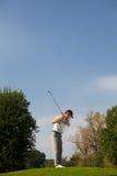leka barn för golfman Arkivfoto