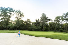 leka barn för golfman Royaltyfri Foto