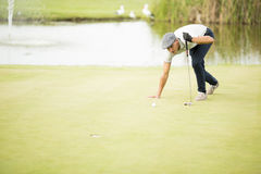 leka barn för golfman Arkivbilder