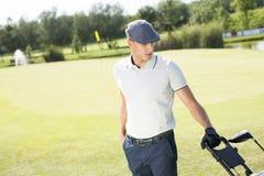 leka barn för golfman Arkivbild