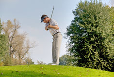 leka barn för golfman Royaltyfria Foton