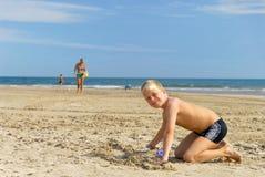 leka för 4 strand Arkivbilder