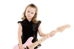 leka för flickagitarr Arkivfoto