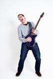 leka för gitarr som är rockstar Royaltyfri Bild