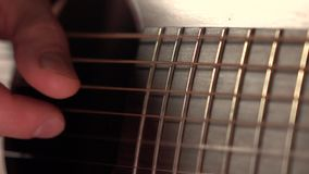 leka för gitarrman Darra rader Toppen ultrarapidmakrovideo arkivfilmer