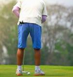 leka för golfman Arkivfoto