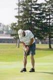 leka för golfman Royaltyfria Bilder