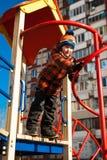 leka för pojkelekplats Fotografering för Bildbyråer