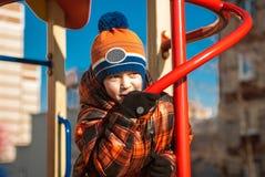 leka för pojkelekplats Arkivbild