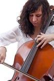 leka för violoncellflicka arkivbilder