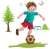 leka för pojkefotboll Fotografering för Bildbyråer