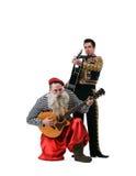 Leka gitarrer för gamal man och för toreador Arkivfoto
