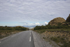 Leka Island, Norway, road to the seawith red mountains. The island of Leka is the northernmost part of Nord-Trøndelag, Norway;  it's Norway's geological Royalty Free Stock Image