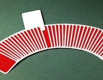 Leka kort i en ro Fotografering för Bildbyråer