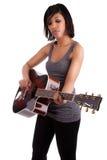 leka kvinnabarn för svart gitarr Arkivfoto