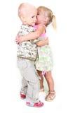 leka litet barn för pojkeflicka tillsammans Arkivbild
