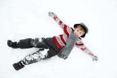 leka snow för pojke royaltyfri bild